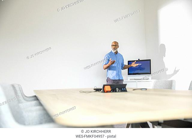 Businessman in conference room leading a presentation