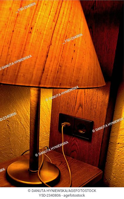close-up of small lamp illuminating interior of room at night