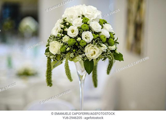 Wedding banquet: centerpiece of white roses