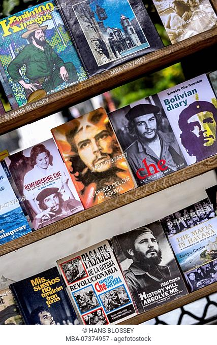 Antique shop, used books about Ernesto Che Guevara and Fidel Castro at the flea market in the streets of Old Havana, La Habana, Cuba, Caribbean, Central America