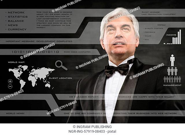 Businessman in black suit working with digital vurtual screen