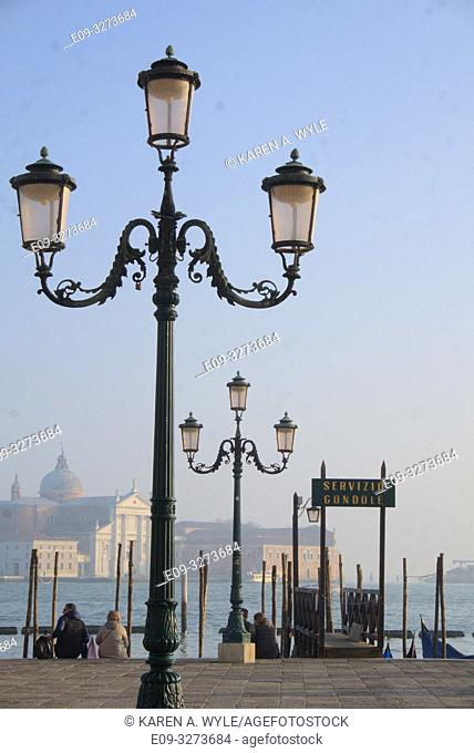 lampposts near gondola dock along Riva degli Schiavoni on Grand Canal, Venice, Italy