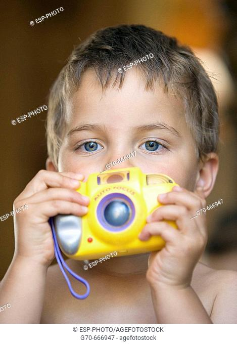 Young boy taking picture