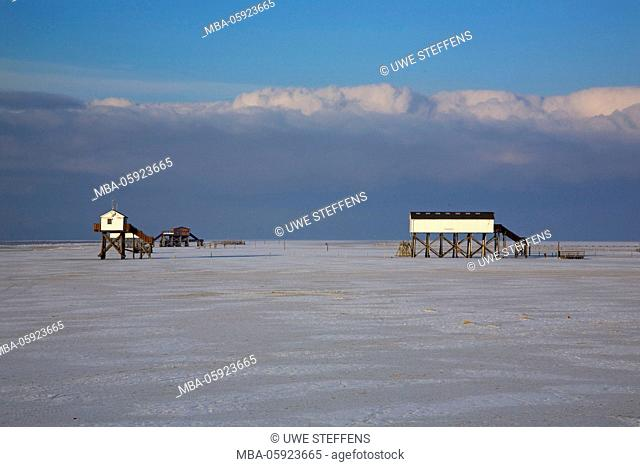 pile dwelling on the wintry beach of Sankt Peter-Ording