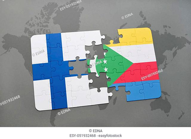 puzzle with the national flag of finland and comoros on a world map background. 3D illustration