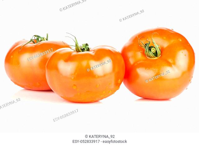 Three red tomato set with vine ends isolated on white background fresh whole