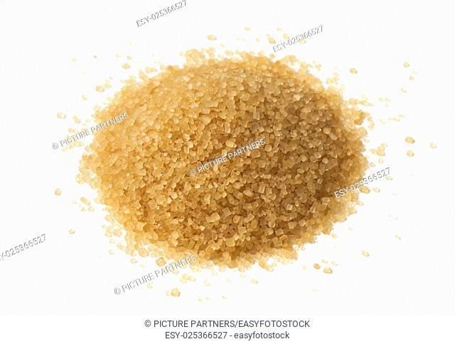 Heap of natural brown sugar on white background