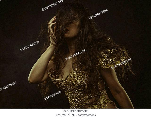 Golden armor, brunette goddess dressed in gold lace dress. concept deity and faith