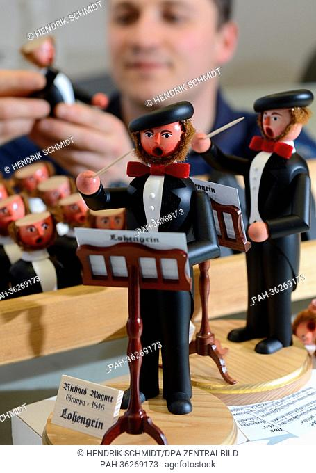 Wooden toy maker assembles wooden incense burning figures that resemble Richard Wagner in his workshop in Seiffen, Saxony, 09 January 2013