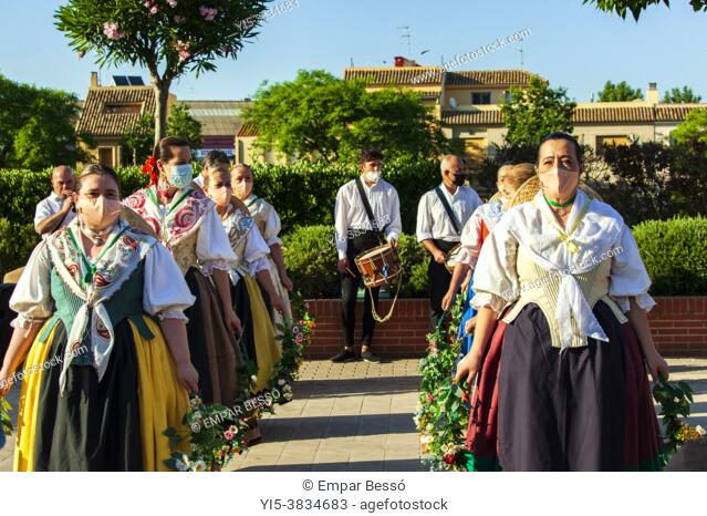 """Dancers with masks because of Covid-19 are preparing to dance """"""""Els Arquets dance"""""""". Corpus dance. Picanya. (València, Spain). June 2021"""