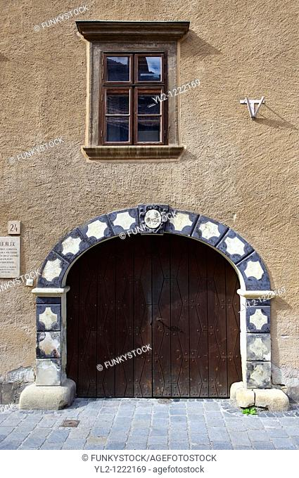 Baroque entrance to the old Gothic Jewish Sinagogue Alt Synagoge with the unusual 9 candle stand - Sopron, Hungary