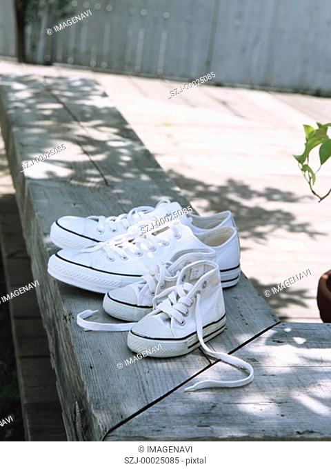 Sneakers of parents and child
