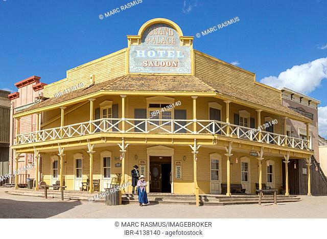 Wild West scenery, big hotel, historically dressed passers-by at the front, Old Tucson Studios, Tucson, Arizona, USA