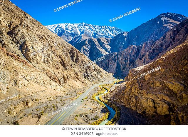 A singular roadway cutting through the Elqui Pisco Valley, Coquimbo, Chile