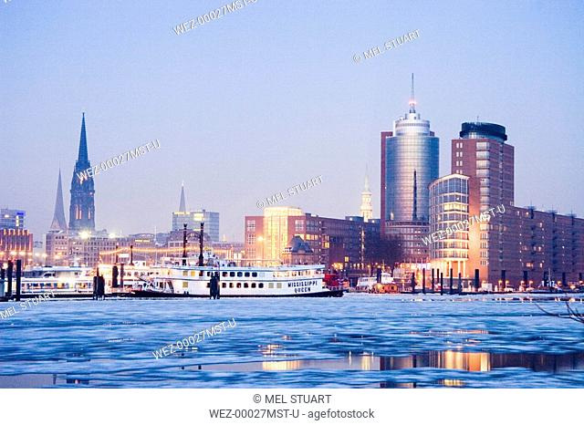 Germany, skyline of Hamburg, Elbe river, view of Hanseatic Trade Center and St. Nicolai church