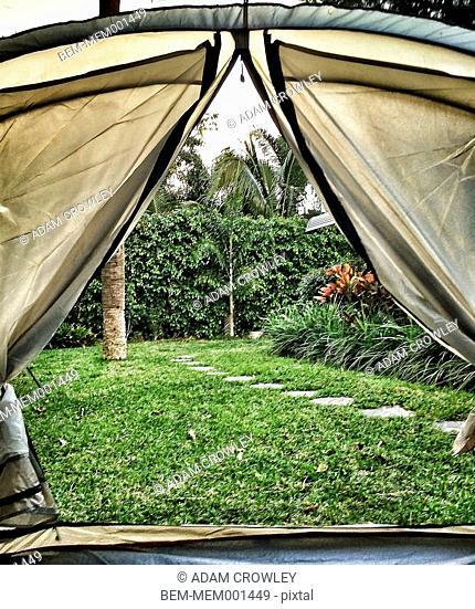 Backyard viewed through tent door