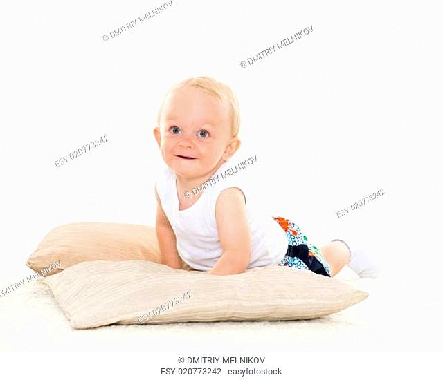 Sweet small baby with pillows
