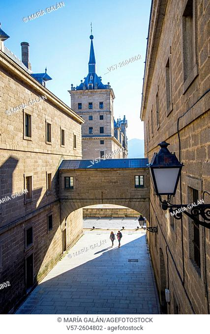 Street, arch and view of the Royal Monastery. San Lorenzo del Escorial, Madrid province, Spain