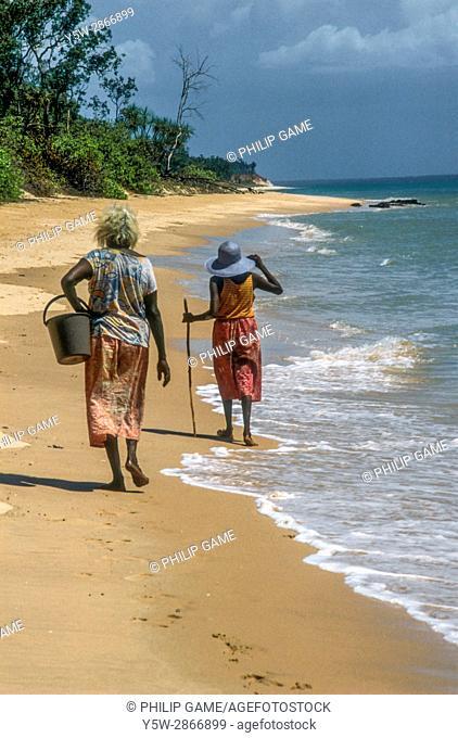 Women browsing the shoreline on Melville Island, Tiwi Islands, Northern Territory, Australia