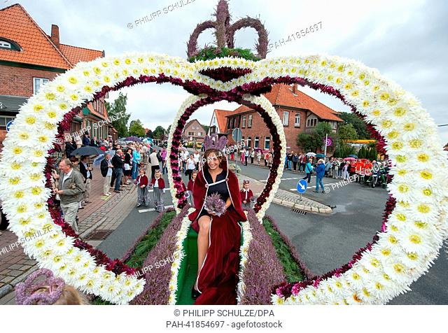19-year-old Lara-Sophie Sebastian smiles after her election as the new Heather Queen in Amelinghausen, Germany, 18 August 2013