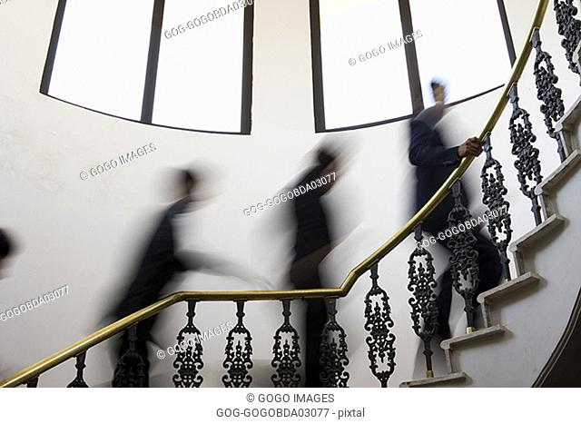 Blurred view of people climbing staircase