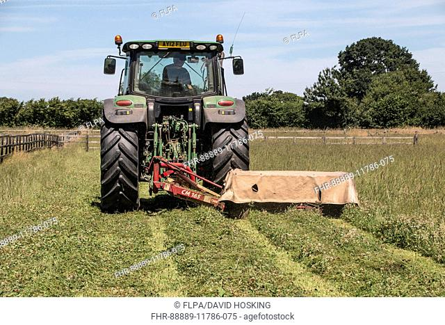 Haymaking, first stage, cutting grass using a twin disc mower