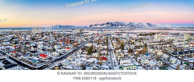 Top view of homes, and roads in the winter, Reykjavik, Iceland. This image is shot with a drone