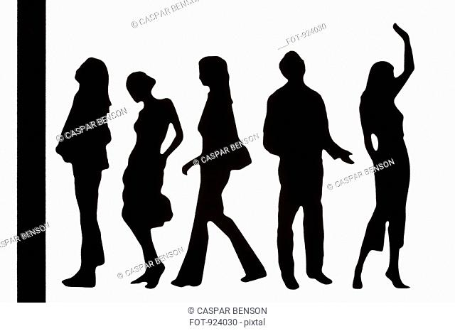 Silhouettes of fashionable plastic figurines standing in a line