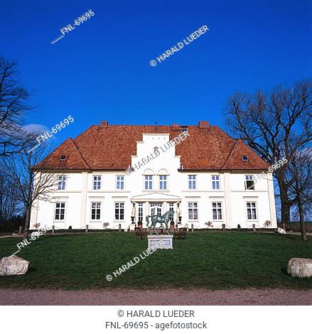 Sculpture of horse in front of house, Mecklenburg-West Pomerania, Germany