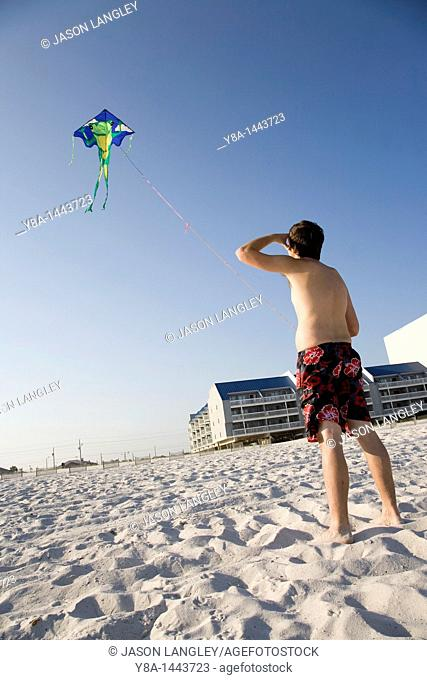 Man flying a kite at the beach in Gulf Shores, Alabama, United States