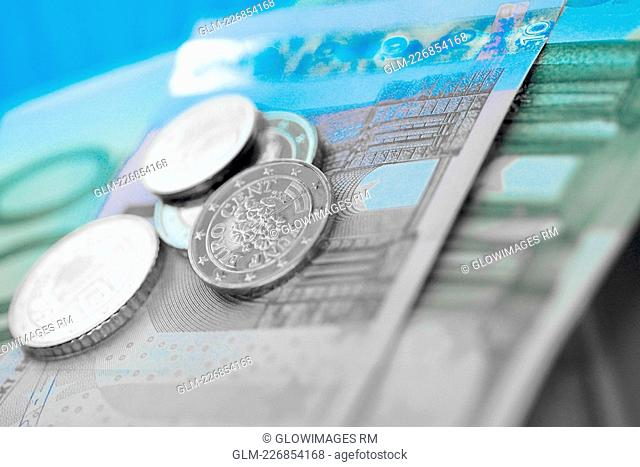 Close-up of European union banknotes with coins