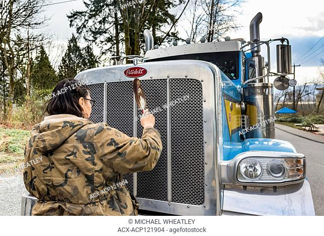 Indigenous woman and Anti Pipeline protesters block truck at entrance to Kinder Morgan Pipeline Terminal, Burnaby, British Columbia, Canada