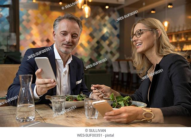 Two business people having lunch in a restaurant
