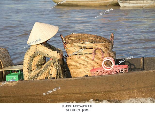 Woman going to market in small boat, Cai Rang floating market, Mekong Delta, Ha Giang Province, Vietnam