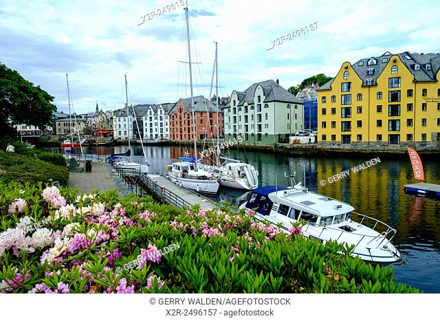 The inner harbour at Alesund (Norway) showing the frontages of old warehouse buildings