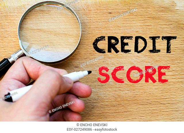 Human hand over wooden background and credit score text concept