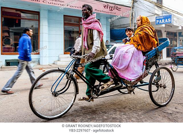 A School Boy Is Taken To School By Rickshaw Taxi, New Delhi, India