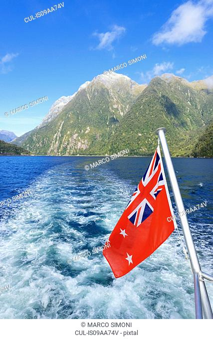 New Zealand flag, Milford Sound, Fiordland National, South Island, Southland, New Zealand
