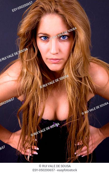 young beautiful woman portrait on a black background