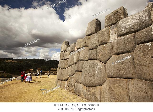 Visitors at the The Saqsaywaman archaeological complex, a massive fortress of the Incas, overlooking the Inca navel of Cusco, Peru, South America