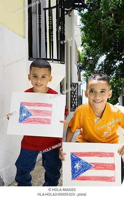 Boys holding drawing of the Puerto Rican flag