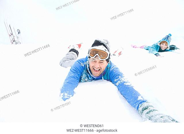 Italy, South Tyrol, Seiseralm, Couple playing in snow