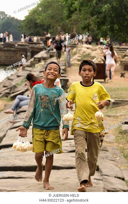 kids selling fruits at Angkor Wat Temple, Cambodia, Asia