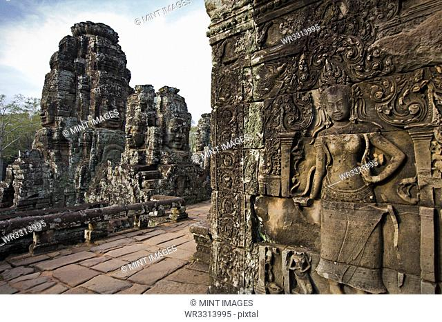 Ornate stone carvings on walls, Angkor, Cambodia