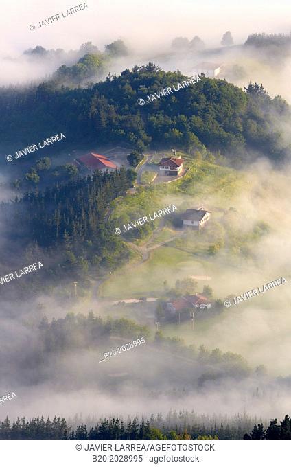 Fog. Basque Farmhouse. Aizkorri Aratz Natural Park. Aloña mount. Arantzazu. Oñati. Gipuzkoa. Basque Country. Spain