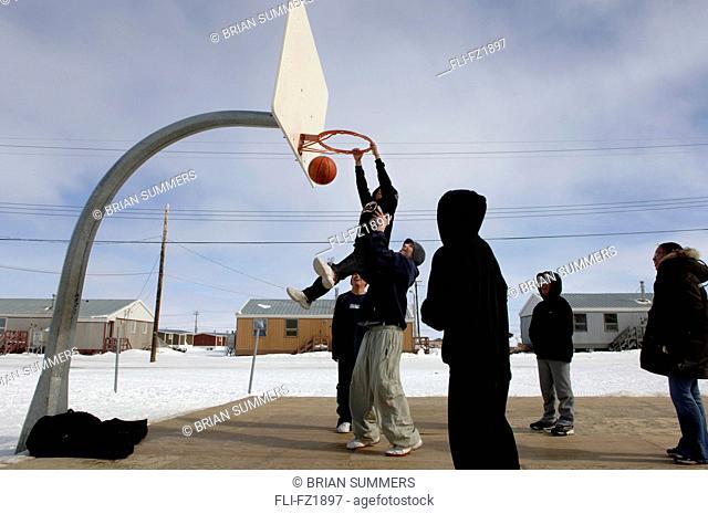 Boys playing basketball, Cambridge Bay, Nunavut