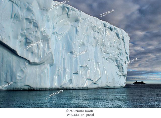 Iceberg and cruising ship, Disco Bay, Greenland