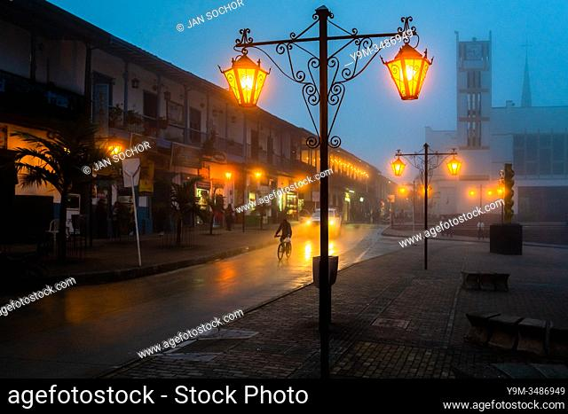 Decorative street lamps are seen shining in the main plaza during the misty nightfall in in Sonsón, a village in the coffee region (Zona cafetera) of Colombia