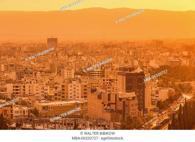 Iran, Central Iran, Shiraz, elevated city skyline from the north, dusk