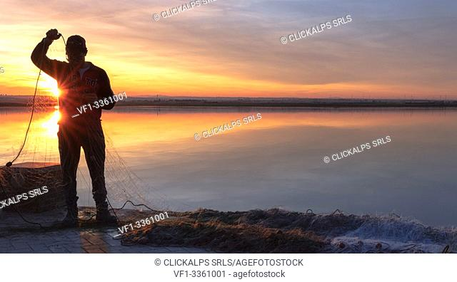 Lesina lake at sunset, Lesina village, Foggia district, Apulia, Italy